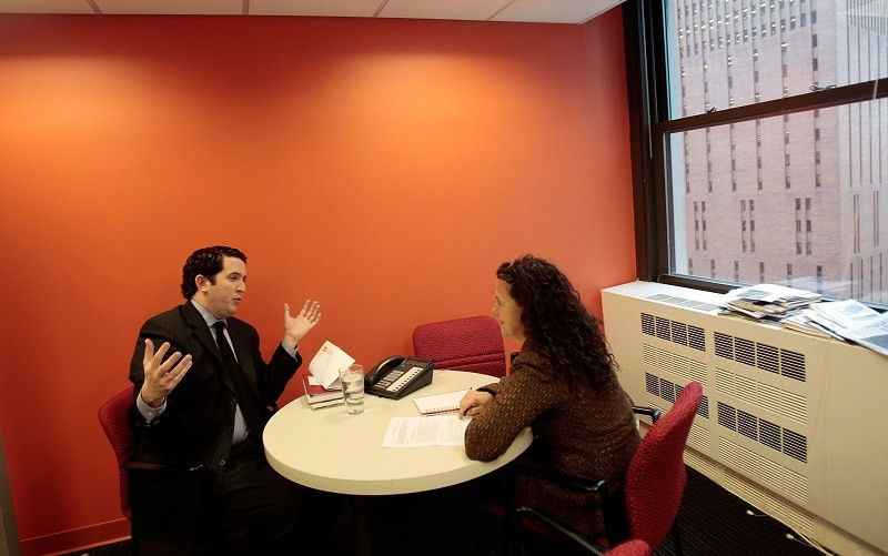 Two professionals meet, one with a pocketful of job interview tips sure to land him the job