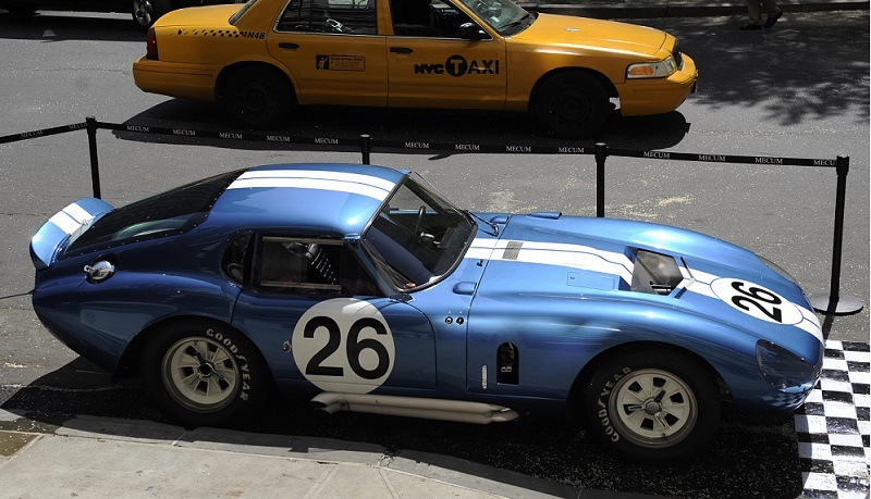 The 1965 Shelby Daytona Cobra Coupe CSX260 stands on display in front of New York's Plaza Hotel, during an auction preview in New York, April 28, 2009. The 1965 Shelby Daytona Cobra was one of six car built by Carroll Shelby and the first American race car to ever beat Ferrari in the world manufacturers racing championship. The car will presented on May 15, 2009 at an auction in Indianapolis and is expected to fetch a world record price for a car, with an estimate of 10-15 million USD.