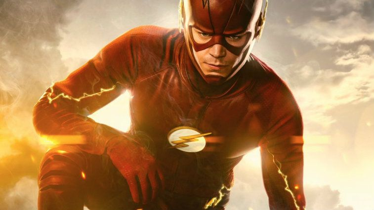 Grant Gustin wears his red suit while running against a cloudy sky in The Flash