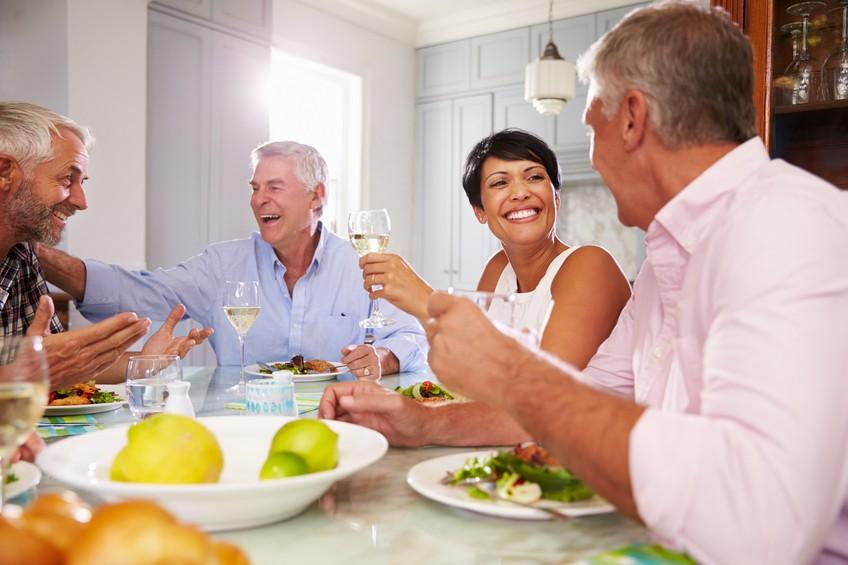 senior friends enjoying meal