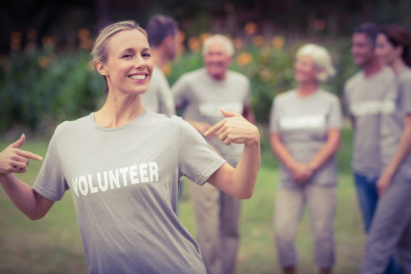 Happy volunteer showing her t-shirt