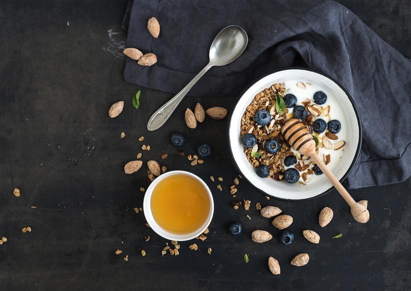 Oat granola with fresh blueberries, almond, yogurt