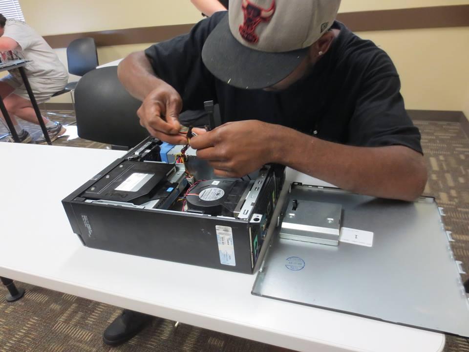 An ITT Tech student works on computer hardware