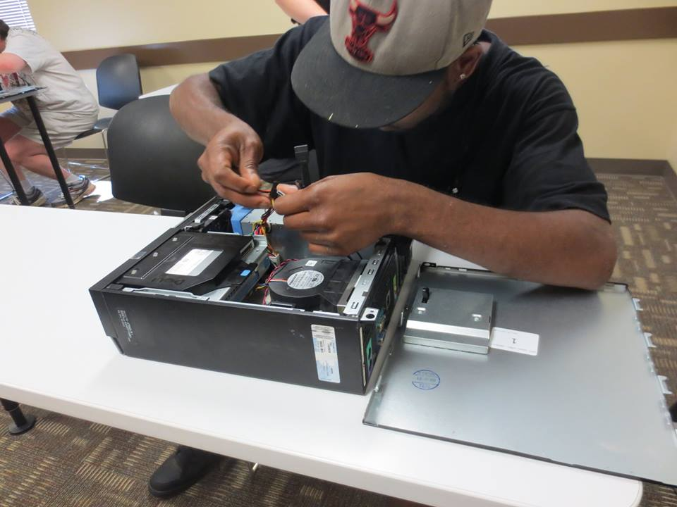 An ITT Tech student works on computer hardware