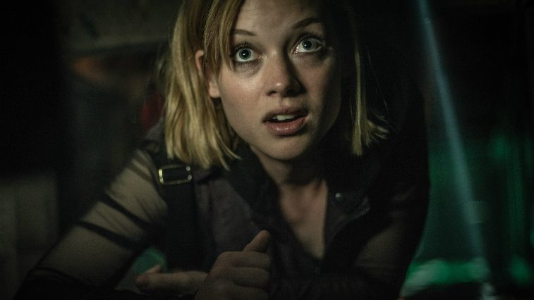 Jane Levy in Don't Breathe hiding on the floor looking terrified