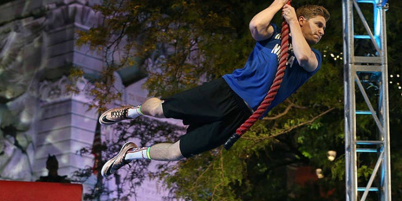 Josef Newgarden swings from a rope on American Ninja Warrior