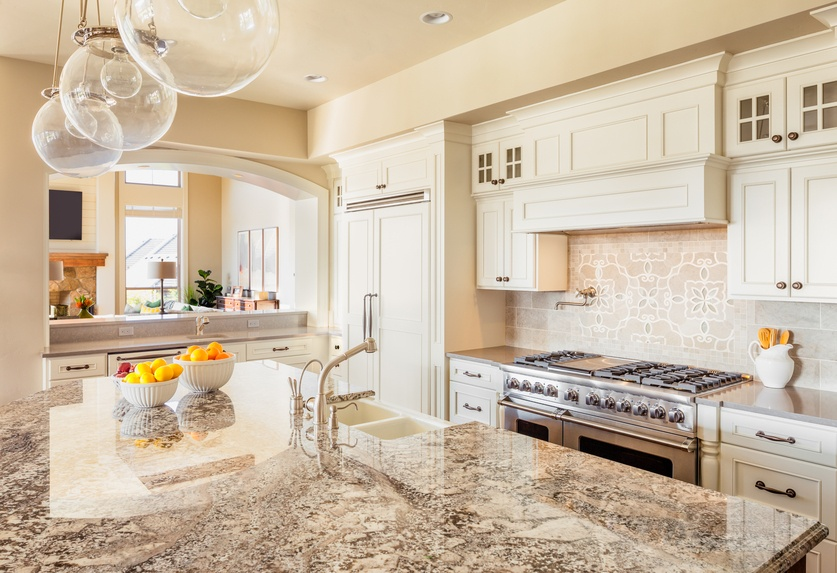 Kitchen with Island, Sink and Cabinets