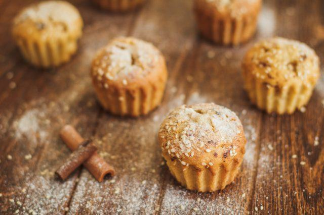 Muffins on a table with sesame and cinnamon.