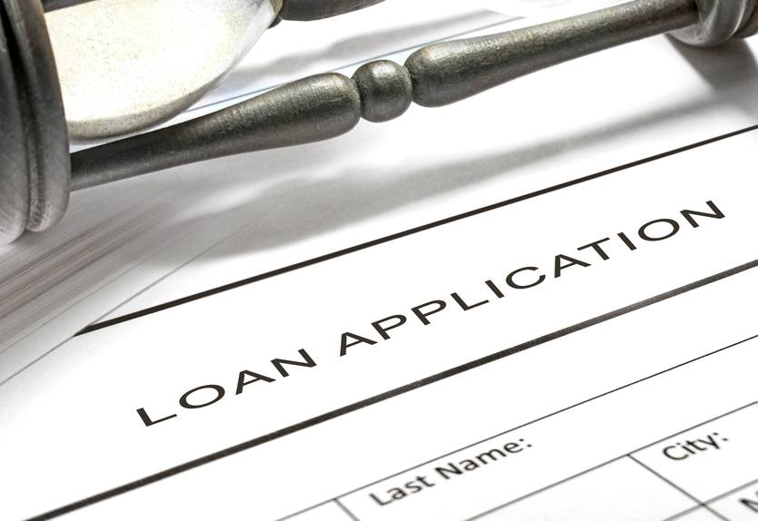 Loan application form with hourglass