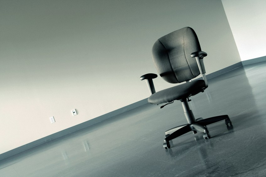 a chair in empty office represents disappearing jobs