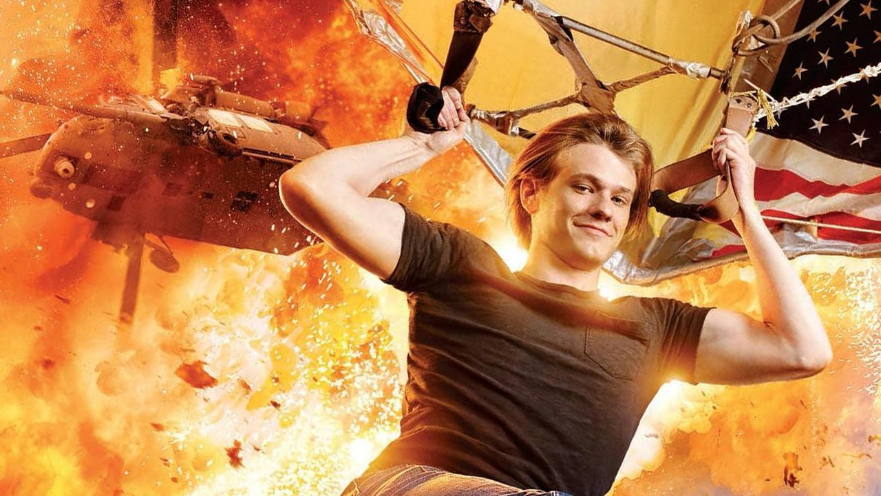 Lucas Till's Macgyver hangs from an airplane