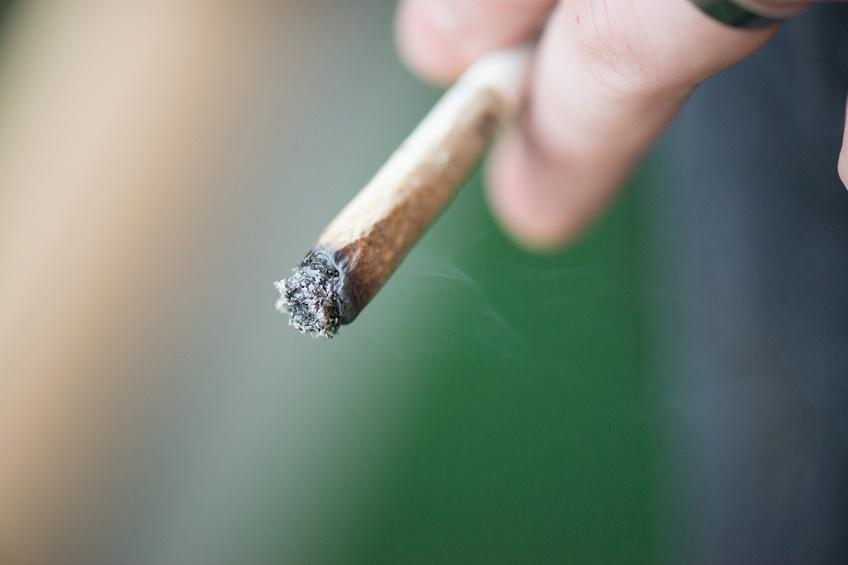 Man smoking marijuana cigarette