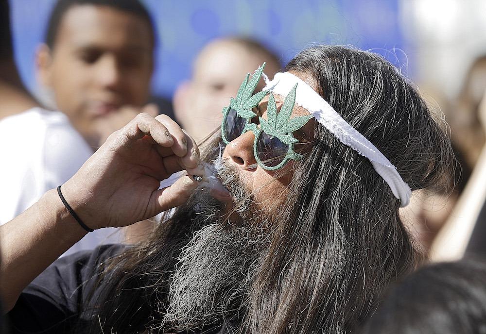man smoking marijuana joint
