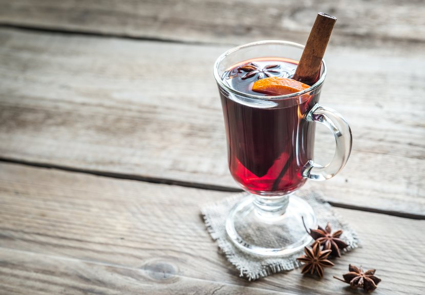 Mulled wine on wooden background