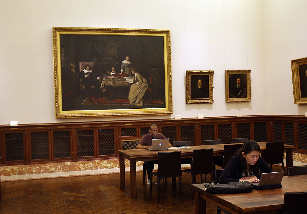 People work on their computers in a newly opened reading room at the New York Public Library