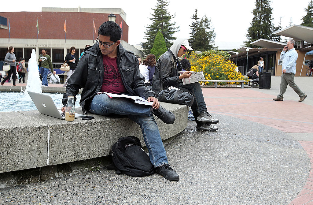A UC Berkeley student works on his laptop