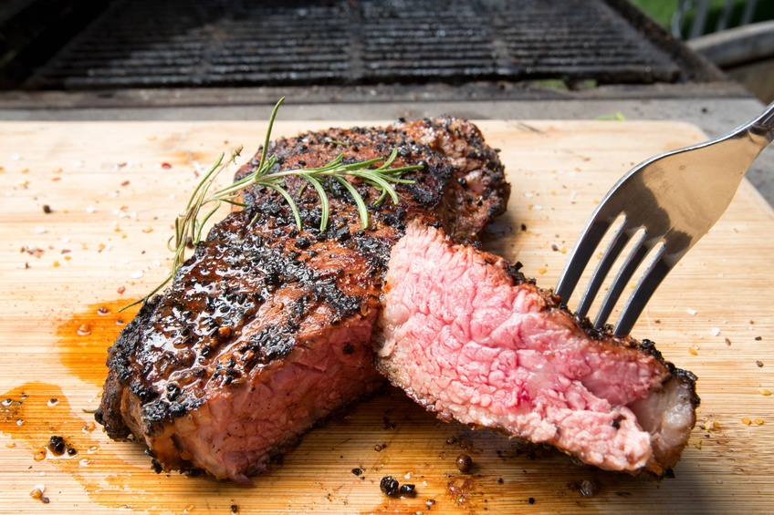 cooked New York Strip garnished
