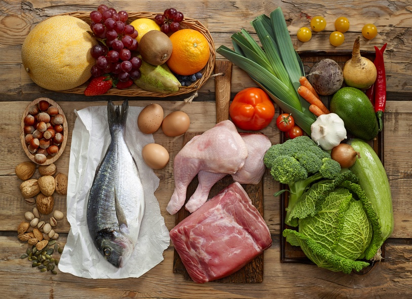 Paleo diet products on wooden table, containing many muscle-building vitamins and minerals