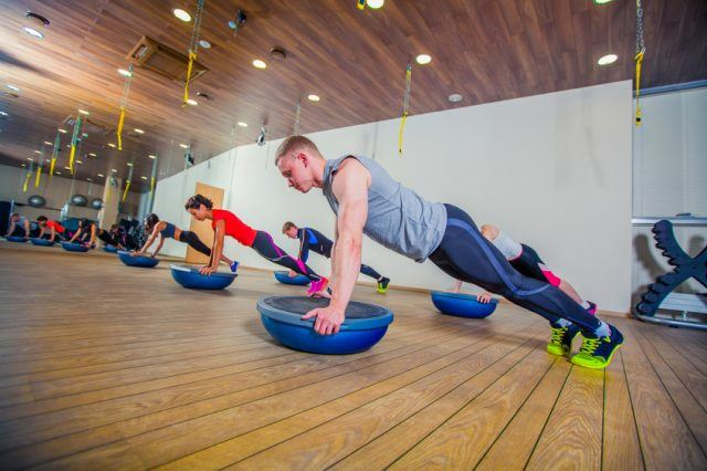 People at the health club with personal trainers.