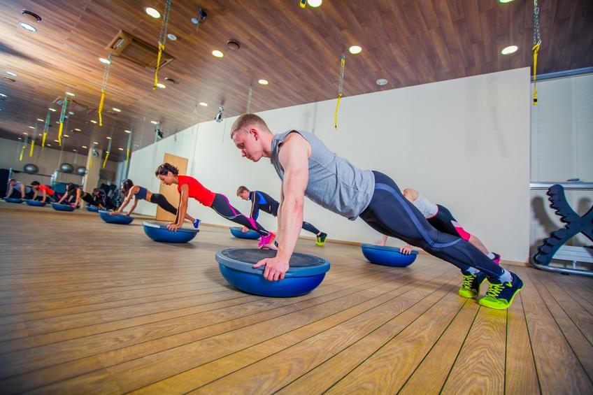 Gym goers exercising