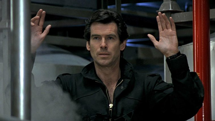 Pierce Brosnan holds up his hands in Goldeneye
