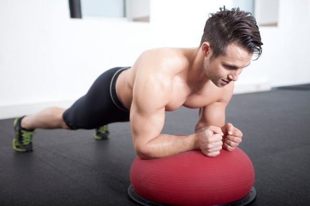 Male athlete performing a plank