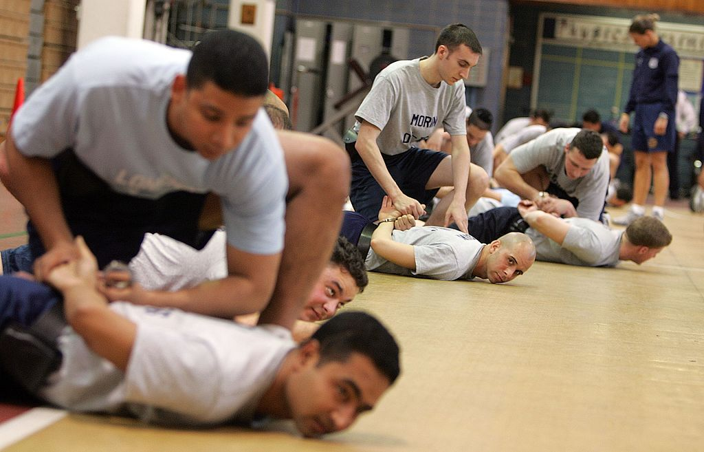 Recruits practice handcuffing techniques while training at the New York City Police Academy
