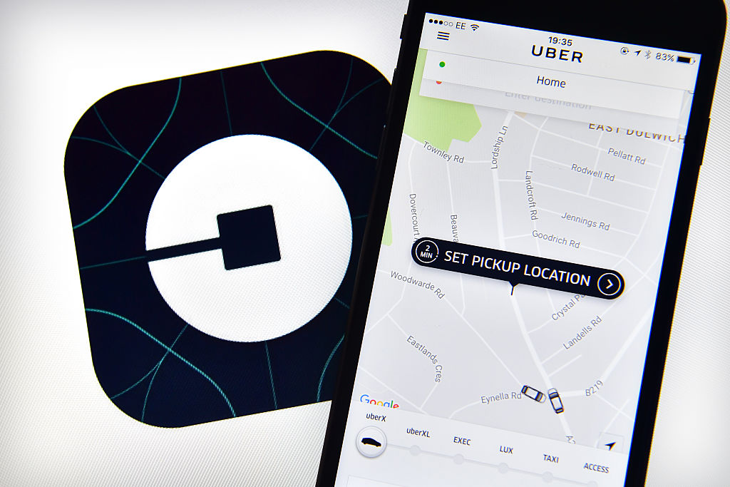 The Uber home page is displayed on an iPhone