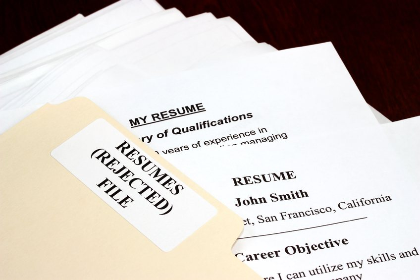 A pile of rejected resumes