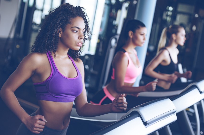 women looking away while running on treadmill