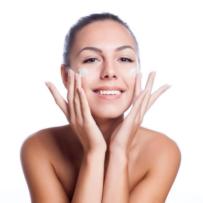 beautiful model applying cosmetic cream