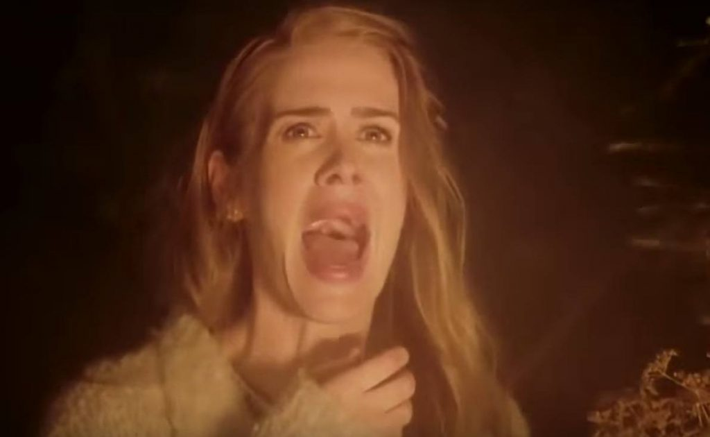 Sarah Paulson screams and holds a hand to her throat in Season 6 of FX's American Horror Story