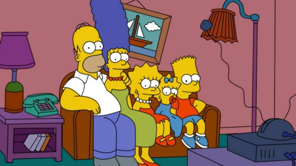The Simpsons family sits on a couch, watching TV