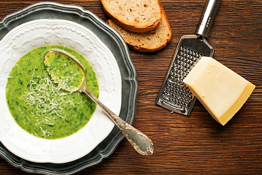 green soup on wooden background