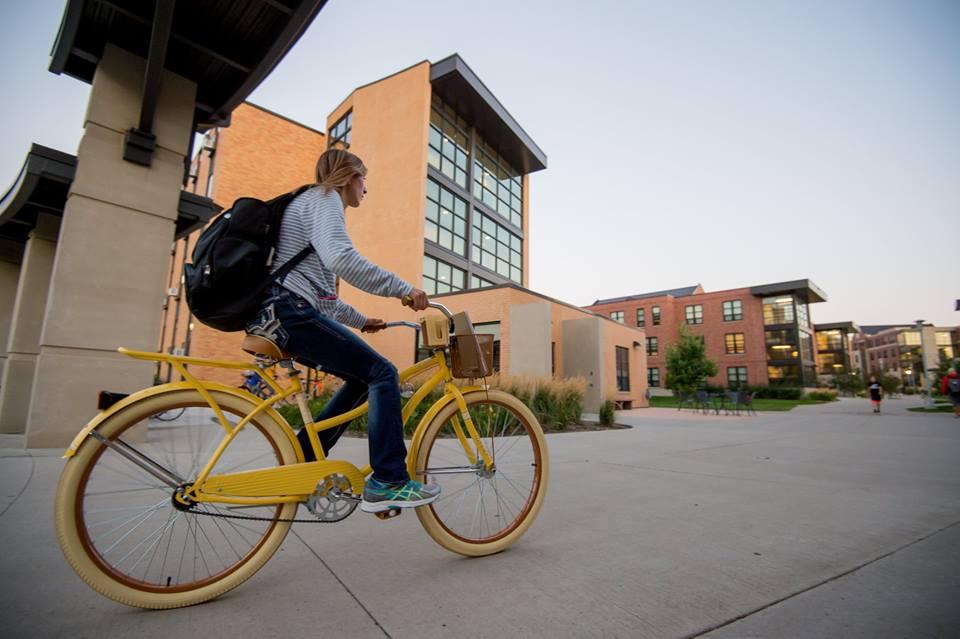 A student bikes to class at South Dakota State University