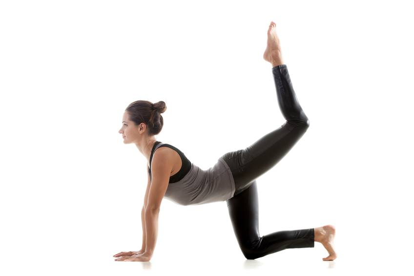 yoga girl doing exercises for her glutes