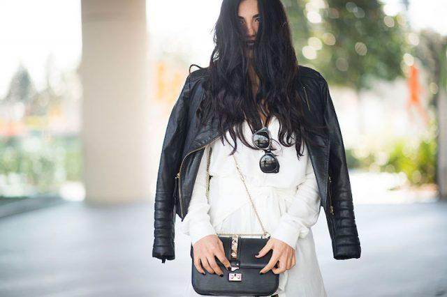 Woman wearing a leather jacket