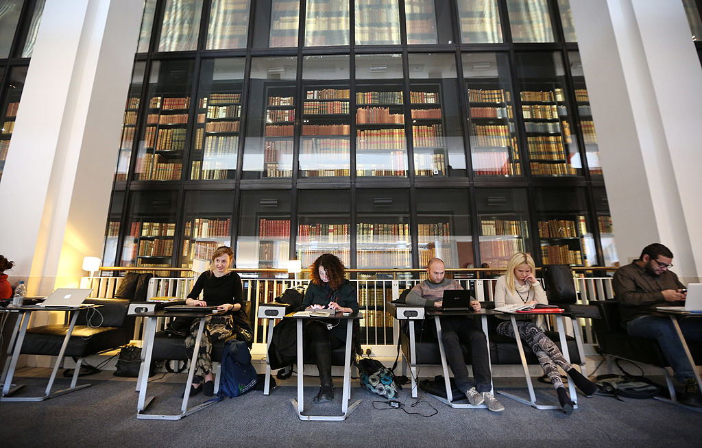 Visitors study and use their laptops at The British Library