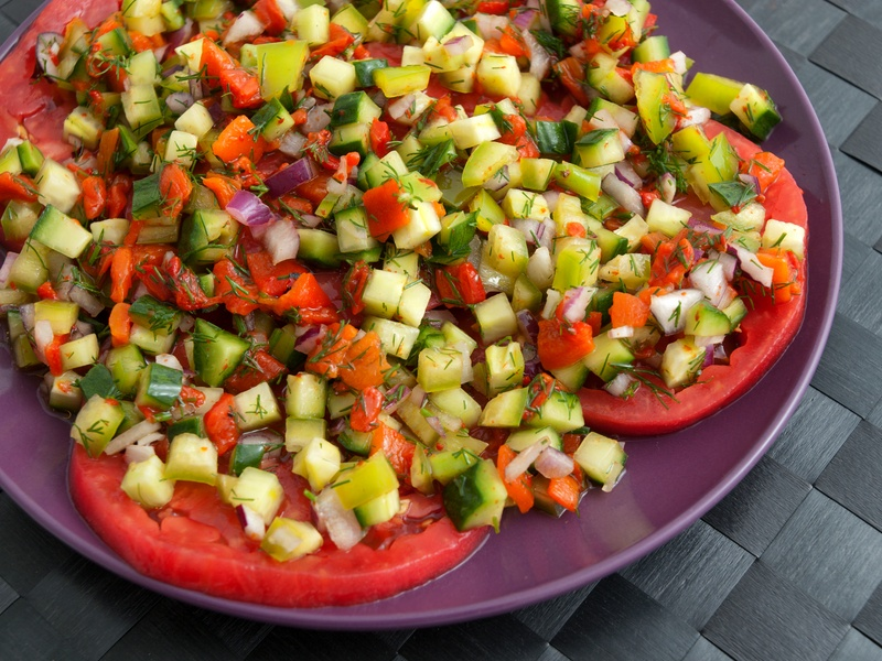 Tomatoes with salsa salad made of cucumbers