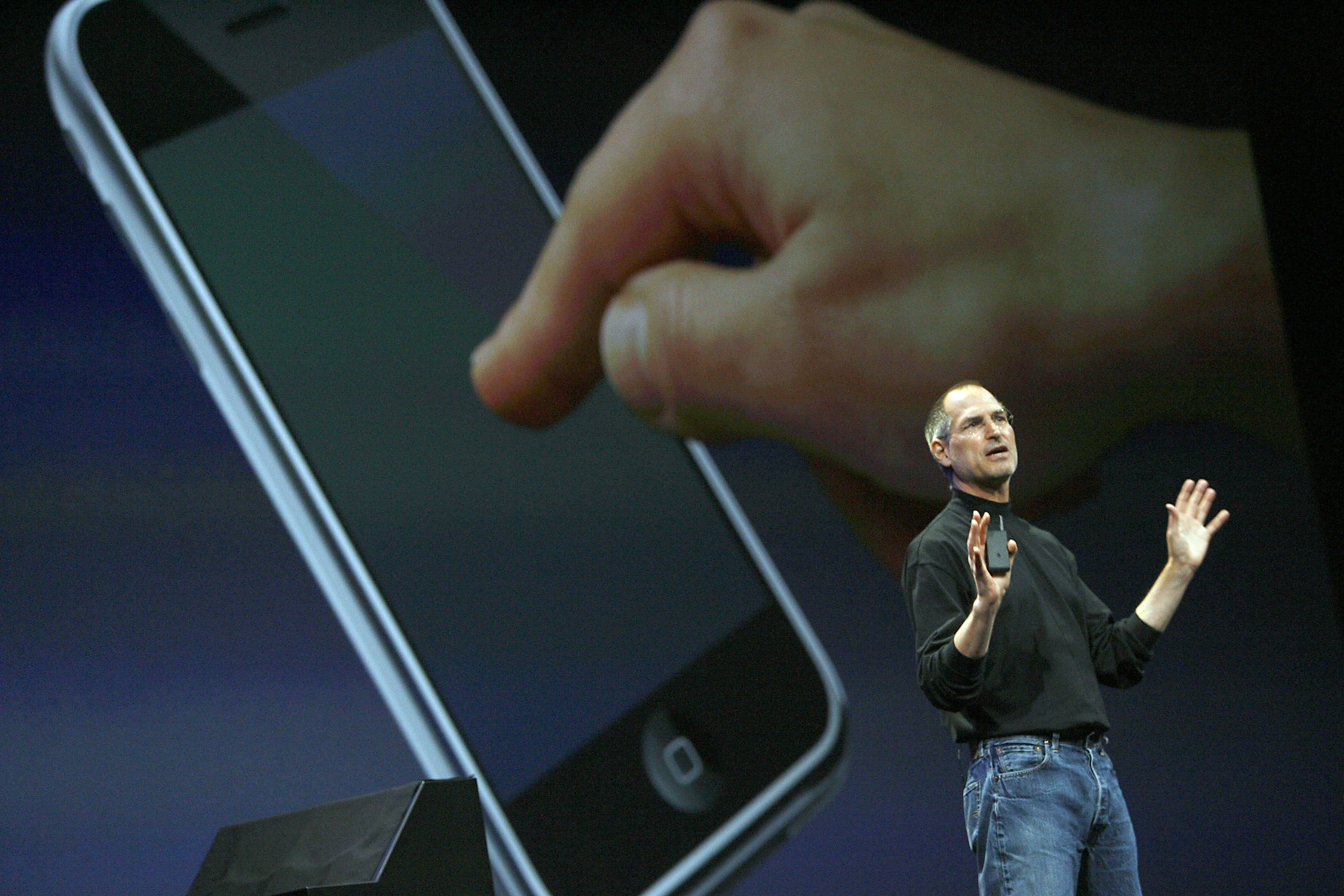 Apple chief executive Steve Jobs unveils a new mobile phone