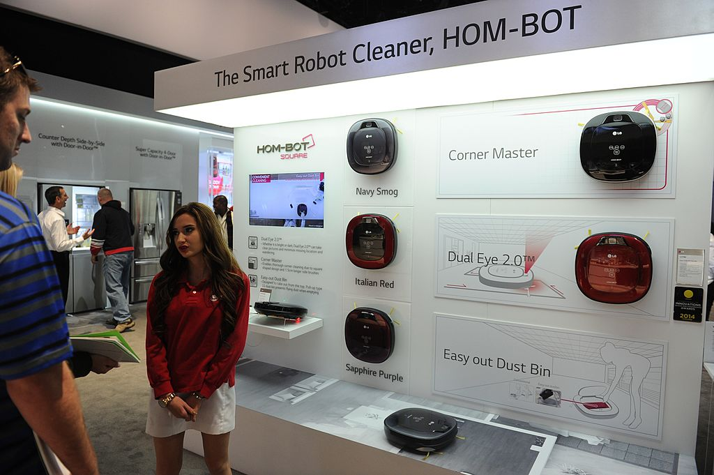 Attendees look at a vacuum cleaner robots