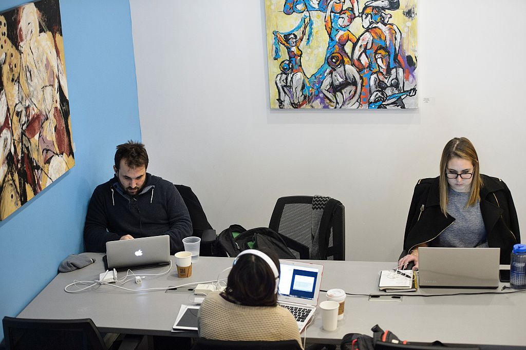 """People work at the """"coworking"""" space Cove   BRENDAN SMIALOWSKI/AFP/Getty Images"""