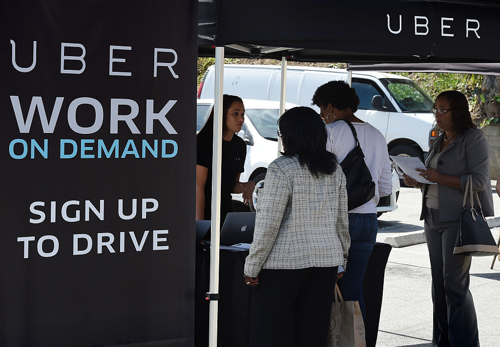 People sign up to become Uber drivers