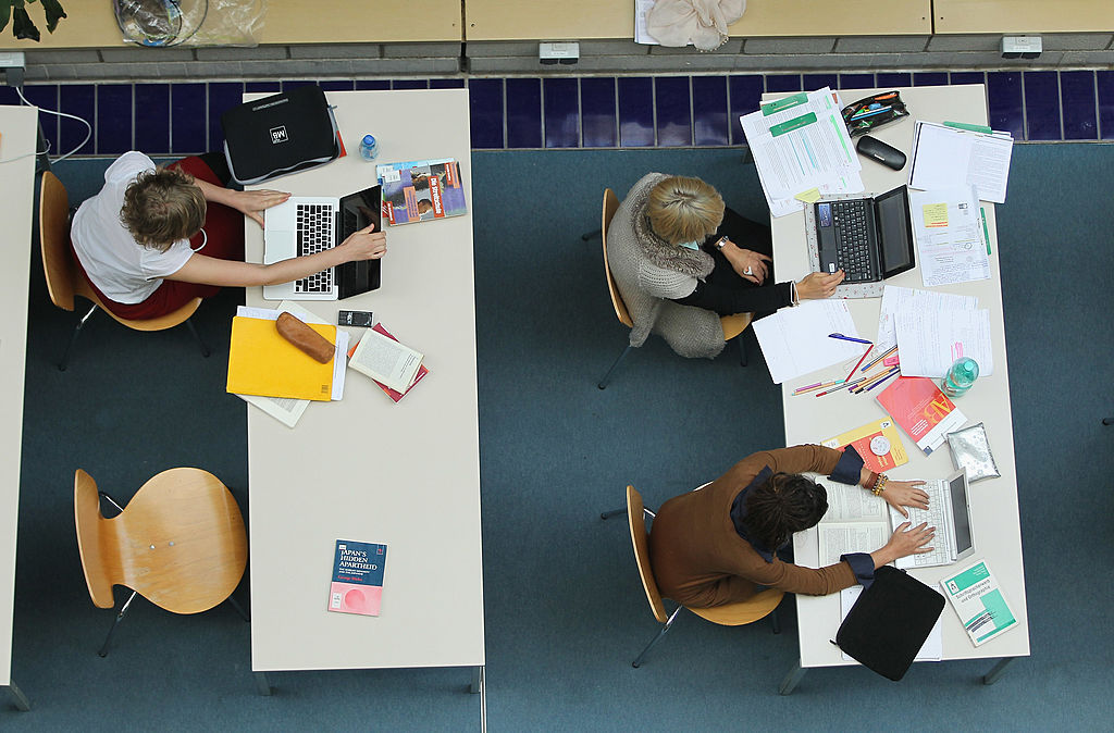 Students study with their laptop computers in the Pedagogical Library