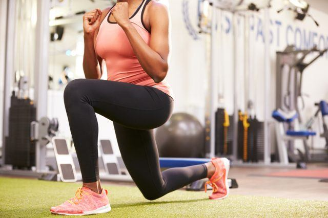 Woman doing lunges in a gym.