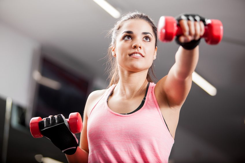 woman working out with some dumbbells