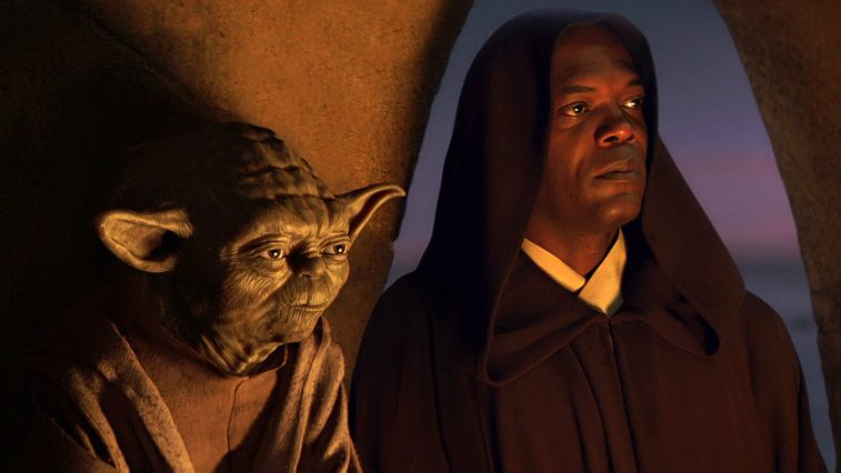Yoda and Samuel L Jackson in Star Wars Episode I The Phantom Menace, with Jackson wearing a brown robe with a hood, lit by a fire