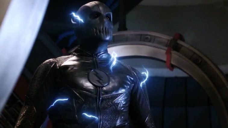 A gray costumed character with a lightning bolt symbol on its chest