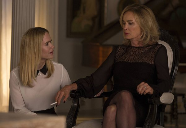 Jessica Lange sitting in a chair