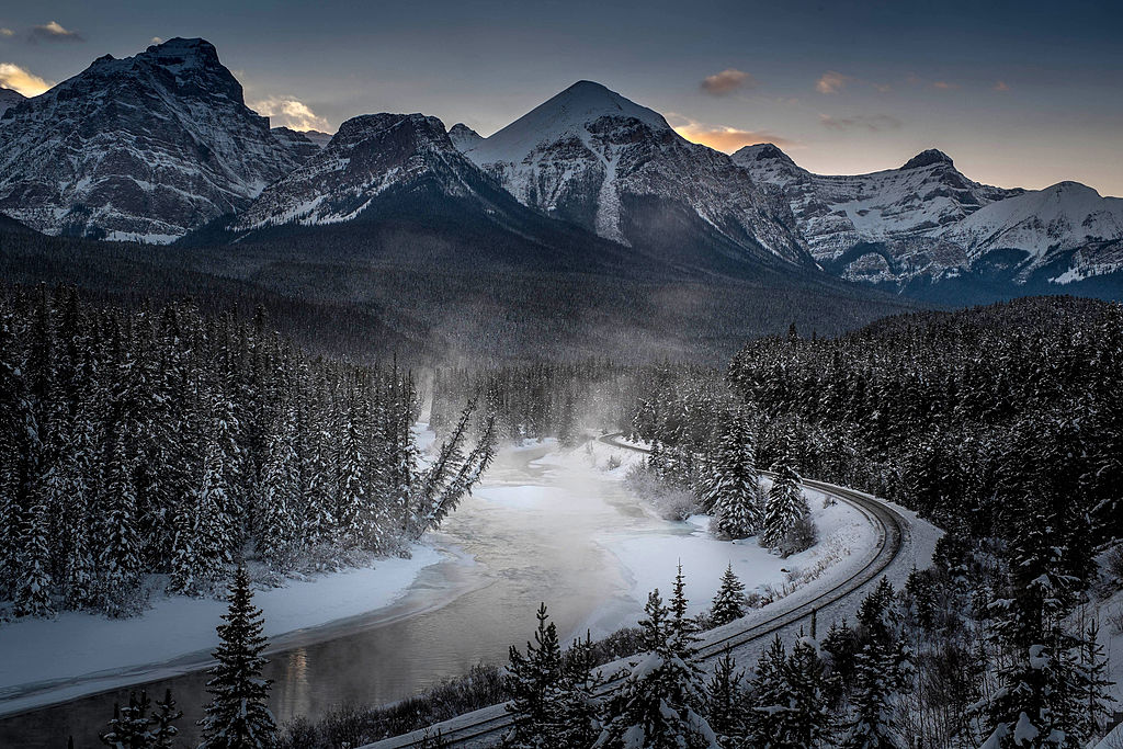 A view of the famous 'Morant's Curve' offering a beautiful view of the frozen Bow River and the Canadian Pacific Railway at Banff National park